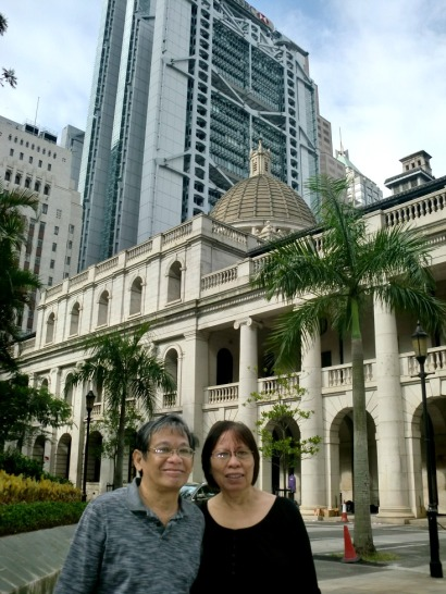My parents standing in front of the Legislative Council building