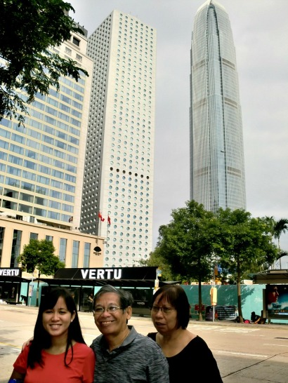 My parents and I with the Jardine House and the IFC as background